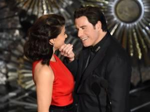 John Travolta grabs Idina Menze's Chin at the 87th annual academy awards.