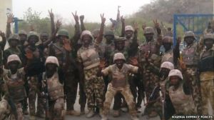 Nigerian soldiers celebrate after recapturing Gwoza