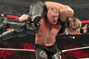 Lesnar hits Rollins with an F5